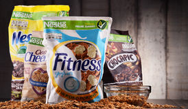 Four packages of Nestle breakfast cereals. POZNAN, POL - MAY 5, 2017: Nestlé is a Swiss transnational food and drink company headquartered in Vevey, Vaud Stock Photos