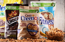 Four packages of Nestle breakfast cereals. POZNAN, POL - MAY 5, 2017: Nestlé is a Swiss transnational food and drink company headquartered in Vevey, Vaud Royalty Free Stock Images