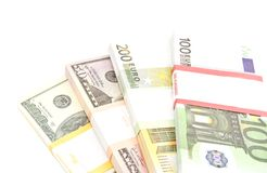 Four packs of dollars and euros banknotes Royalty Free Stock Photo
