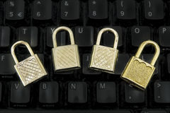 Four padlocks on the black keyboard Royalty Free Stock Images