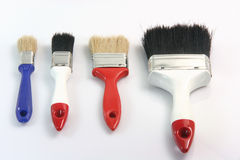 Four paint brushes royalty free stock photos