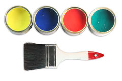 Four paint cans. White paint brush and four open paint cans on white background stock photos