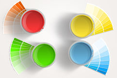 Four paint cans - yellow, red, blue, green on white background. Four paint cans - yellow, red, blue, green with paint samplers on white background Stock Images