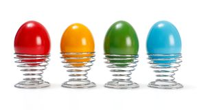 Painted Easter eggs in metal cup Stock Photo