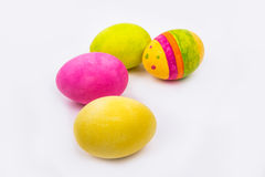 Four painted Easter eggs on a white background. Four painted Easter eggs, one yellow, one green, one pink and one multi-colored on a white background Stock Images