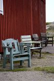 four pair of chairs outside a red old house Royalty Free Stock Photography