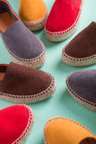 Four pair of espadrilles on mint color background. Close up. Royalty Free Stock Photo