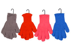 Four pairs of colorful gloves Royalty Free Stock Photo