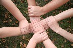 Four pairs of hands Stock Photo