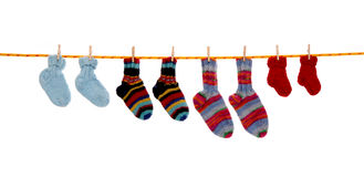 Four pairs of isolated handmade wool socks hanging on a rope. Royalty Free Stock Images