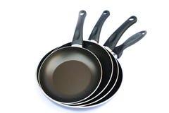 Four pans Stock Photos