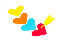 Four paper colored heart shapes with arrow Royalty Free Stock Images