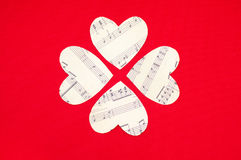 Four paper heart on red background Stock Photos