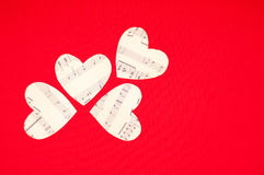Four paper heart on red background stock photo