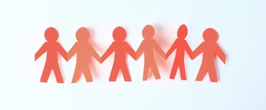Four paper men taking each other`s hands stock image