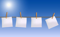 Four paper notes hanging on rope Royalty Free Stock Photo