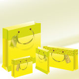 Four paper package of yellow color Stock Image