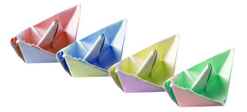 Four paper ships. Paper ships in different colors Royalty Free Stock Image