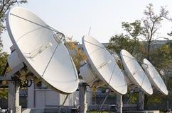 Four parabola antenna. Four high power satellite antennae facing the sky Royalty Free Stock Photography