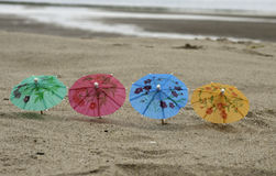Four parasol on the beach Royalty Free Stock Image