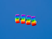 Four paratrooper. Four colored parachutes on blue sky Stock Photo