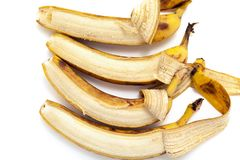 Four partially peeled banana lying in vertical row Royalty Free Stock Photography