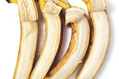 Four partly peeled banana lie in horizontal row Stock Images