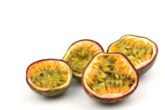 Four passion fruit halves Stock Photos