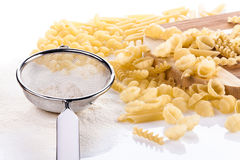 Four pasta types with flower and kitchen utensil Royalty Free Stock Photography