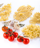 Four pasta types with garlic and tomatoes stock photos