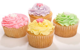 Four Pastel Cupcakes Royalty Free Stock Photography