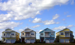 Four pastel houses. Four new american dream pastel colored houses side by side Royalty Free Stock Photography
