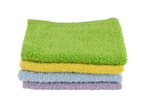Four Pastel wash cloths. Four wash cloths in pastel colors on white background Stock Image