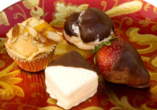 Four Pastry Bites. Four snacks on a colorful plate Stock Photo