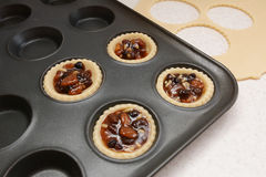 Four pastry cases filled with mincemeat Stock Photos