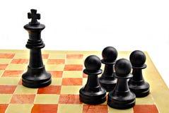 Four pawns black color Stock Photos