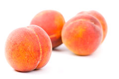 Four peaches. On white background Stock Photos