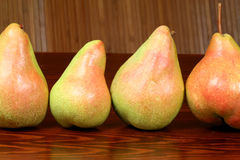 Four pears. Four fresh pears on the table Royalty Free Stock Photos