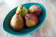 Four Pears In Blue Bowl Royalty Free Stock Images