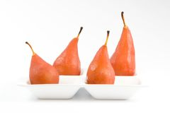 Four pears poached in red wine Stock Image