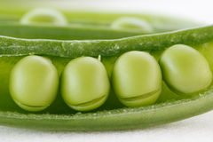 Four peas in a pod. Four green peas in a pod stock photo