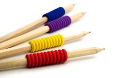 Four pencils with colourful grips Royalty Free Stock Images