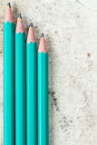 Four pencils on old canvas Stock Image