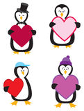Four Penguins With Hearts Royalty Free Stock Image