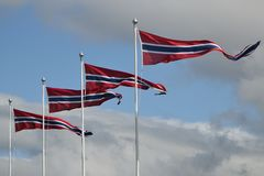 Four pennants fluttering in a wind. Against a cloudy sky in Norway Royalty Free Stock Photos