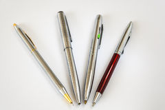 Four Pens On White Background. Macro Image Of Four Ballpoint Pens On White Background Royalty Free Stock Image