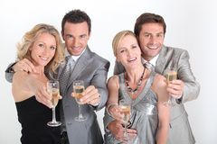 Four people celebrating Royalty Free Stock Photo
