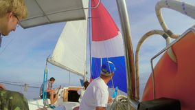 Four people crew on sailing yacht, open sea, traveling, vacation. Stock footage stock footage