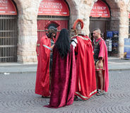 Four people dressed as legionaries stand at the Piazza Bra. Verona, Italy, September 27, 2015 : Four people dressed in the form of Roman legionaries stand at the Royalty Free Stock Photos