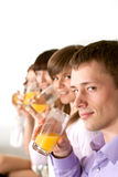 Four people drink juice Royalty Free Stock Photo